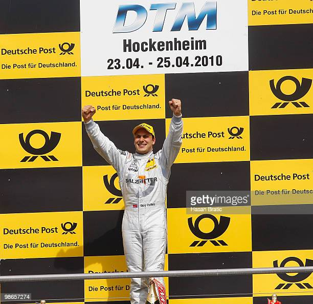 Mercedes driver Gary Paffett of Great Britain celebrate his victory after the race of the DTM 2010 German Touring Car Championship on April 25 2010...