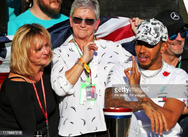 Mercedes driver Lewis Hamilton celebrates winning his sixth world championship with his mum Carmen Larbalestier after the United States Grand Prix at...