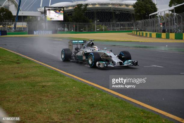 Mercedes driver Lewis Hamilton of Britain controls his car on turn two during the qualifying session at Albert Park ahead of the Australian Formula...