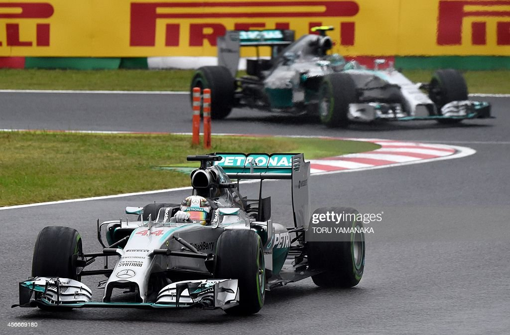 Mercedes driver Lewis Hamilton (front) of Britain leads his teammate Nico Rosberg of Germany at the Formula One Japanese Grand Prix in Suzuka on October 5, 2014. AFP PHOTO/Toru YAMANAKA