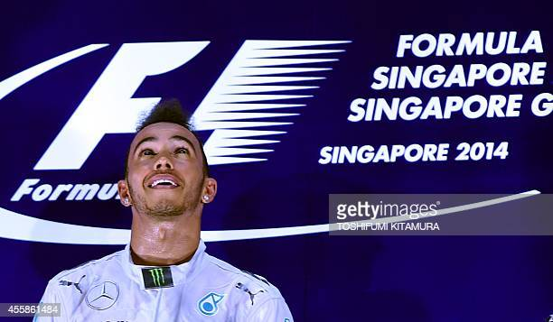 Mercedes driver Lewis Hamilton of Britain reacts on the podium after the Formula One Singapore Grand Prix at the Marina Bay street circuit on...