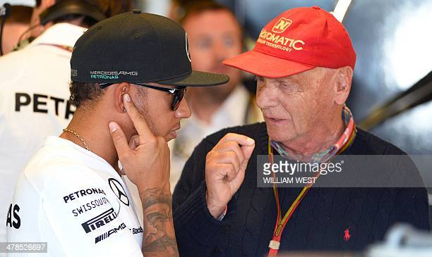 Mercedes driver Lewis Hamilton of Britain speaks with former racing driver Nikki Lauda during the first practice session at the Formula One...