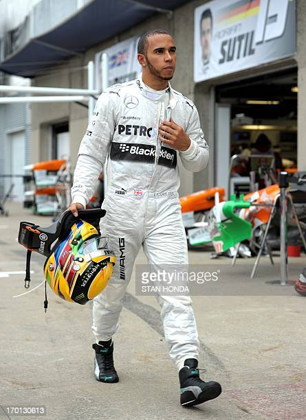 Mercedes driver Lewis Hamilton of Britain walks back to his pit after practice at the Canadian Formula One Grand Prix at the Circuit Gilles...