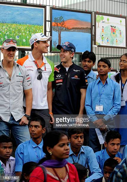 Mercedes driver Michael Schumacher of Germany Force IndiaMercedes driver Adrian Sutil of Germany and Red BullRenault driver Sebastian Vettel of...