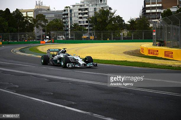 Mercedes driver Nico Rosberg of Germany controls his car on turn two during the qualifying session at Albert Park ahead of the Australian Formula One...