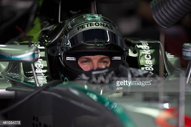 Mercedes driver Nico Rosberg of Germany looks on during the second practice session ahead of the Formula One Malaysian Grand Prix in Sepang outside...