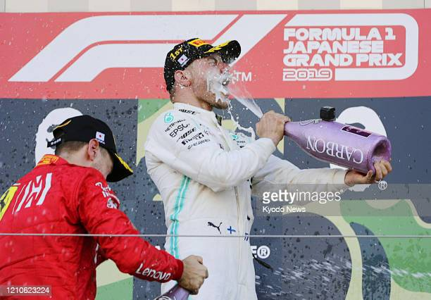 Mercedes driver Valtteri Bottas celebrates after winning the Formula One Japanese Grand Prix in Suzuka, Mie Prefecture, on Oct. 13, 2019.