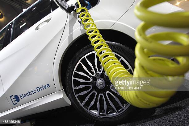 A Mercedes electric drive car is plugged for charging during the second press day of the 66th IAA auto show in Frankfurt am Main western Germany on...