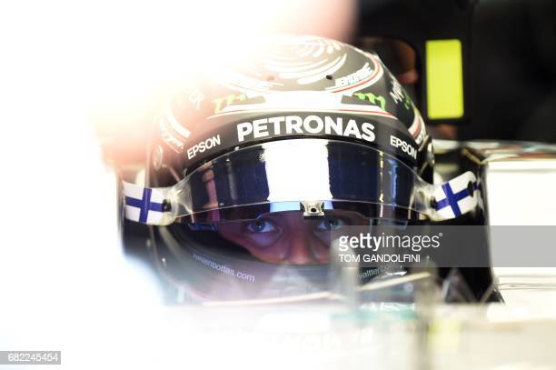 Mercedes' Finish driver Valtteri Bottas looks at a screen in the pits during the first practice session at the Circuit de Catalunya on May 12 2017 in...