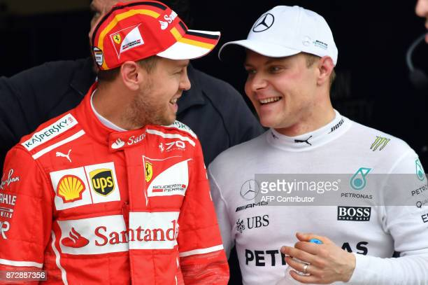 Mercedes' Finnish driver Valtteri Bottas and Ferrari's German driver Sebastian Vettel chat after taking the first and second place for the start of...