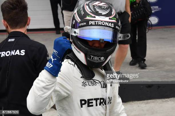 Mercedes' Finnish driver Valtteri Bottas celebrates after taking the pole position for the Brazilian Formula One Grand Prix in the Q3 qualifying...