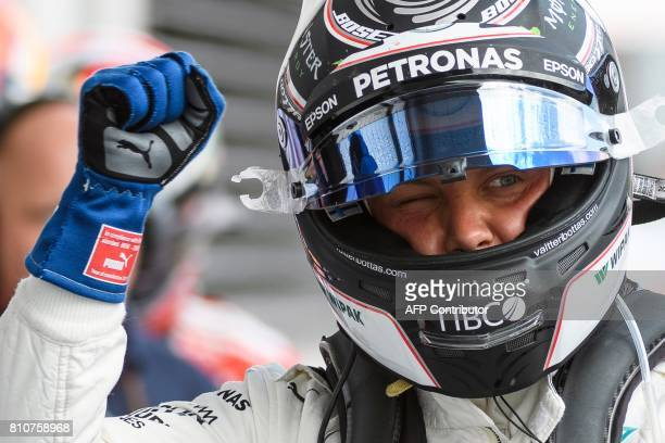 Mercedes' Finnish driver Valtteri Bottas celebrates after winning the pole position during the qualifying session of the Formula One Austria Grand...