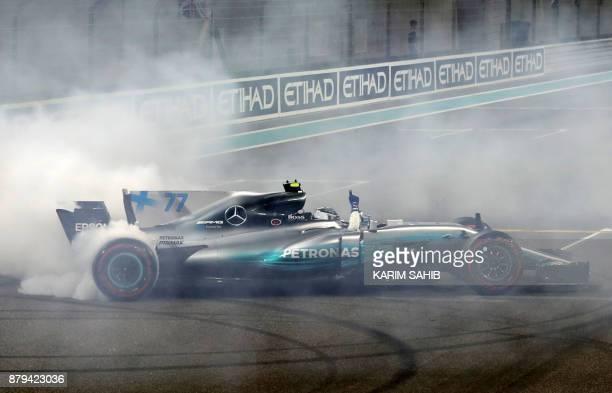 TOPSHOT Mercedes' Finnish driver Valtteri Bottas celebrates at the end of the Abu Dhabi Formula One Grand Prix at the Yas Marina circuit on November...