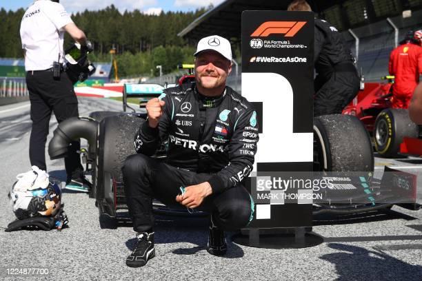 Mercedes' Finnish driver Valtteri Bottas celebrates winning the Austrian Formula One Grand Prix race on July 5, 2020 in Spielberg, Austria.