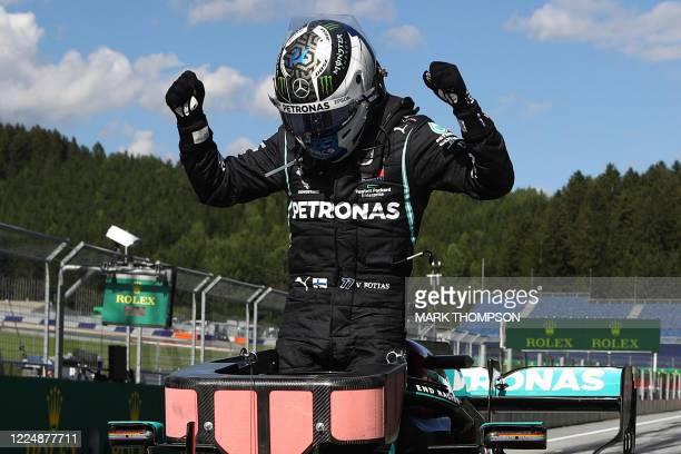 Mercedes' Finnish driver Valtteri Bottas celebrates winning the Austrian Formula One Grand Prix race on July 5 2020 in Spielberg Austria /...