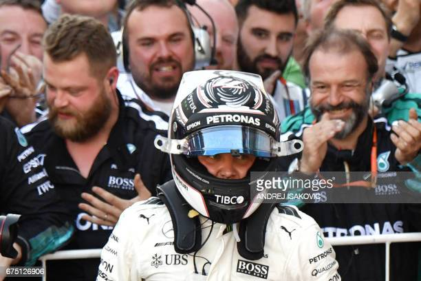 TOPSHOT Mercedes' Finnish driver Valtteri Bottas celebrates with the team's crew after winning the Formula One Russian Grand Prix at the Sochi...
