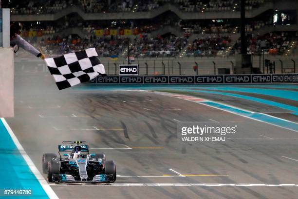 Mercedes' Finnish driver Valtteri Bottas crosses the finish line during the Abu Dhabi Formula One Grand Prix at the Yas Marina circuit on November 26...