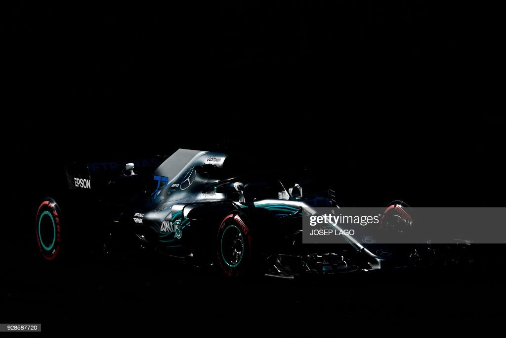 TOPSHOT - Mercedes' Finnish driver Valtteri Bottas drives at the Circuit de Catalunya on March 7, 2018 in Montmelo on the outskirts of Barcelona during the second day of the second week of tests for the Formula One Grand Prix season. / AFP PHOTO / Josep LAGO