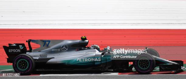 Mercedes' Finnish driver Valtteri Bottas drives his car during the Formula One Austria Grand Prix at the Red Bull Ring in Spielberg on July 9 2017 /...