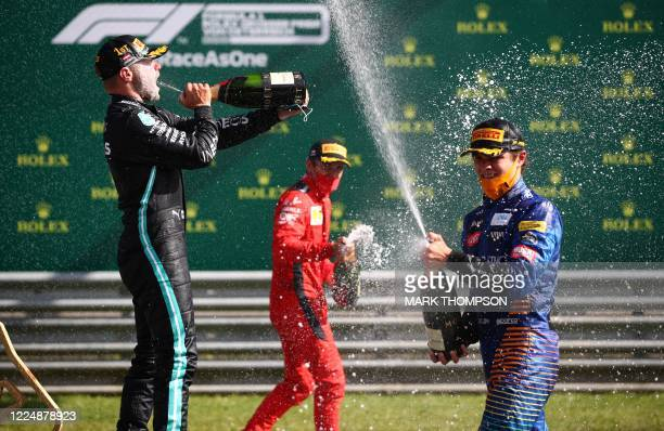 Mercedes' Finnish driver Valtteri Bottas Ferrari's Monegasque driver Charles Leclerc and McLaren's British driver Lando Norris celebrate with...