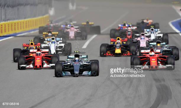 Mercedes' Finnish driver Valtteri Bottas leads after the start of the Formula One Russian Grand Prix at the Sochi Autodrom circuit in Sochi on April...
