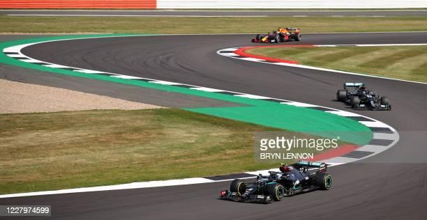 Mercedes' Finnish driver Valtteri Bottas leads Mercedes' British driver Lewis Hamilton during the F1 70th Anniversary Grand Prix at Silverstone on...