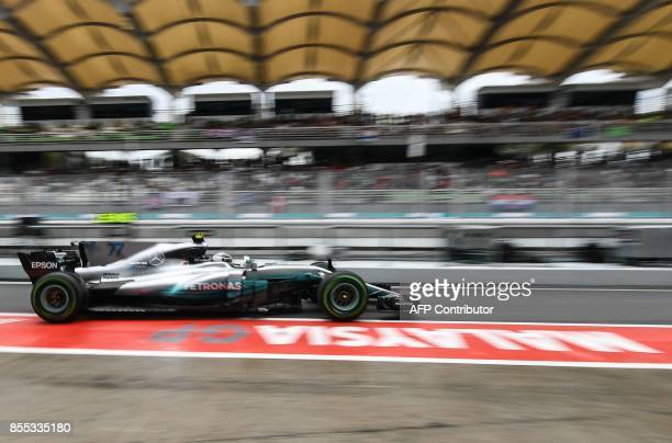 TOPSHOT Mercedes' Finnish driver Valtteri Bottas leaves the pit lane during the first practice session of the Formula One Malaysia Grand Prix in...