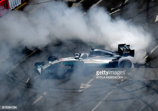 TOPSHOT Mercedes' Finnish driver Valtteri Bottas performs his skills on May 1 2017 during a special car show in Budapest Hungary / AFP PHOTO / ATTILA...