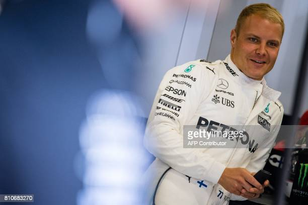 Mercedes' Finnish driver Valtteri Bottas prepares for the third practice session of the Formula One Austria Grand Prix at the Red Bull Ring in...