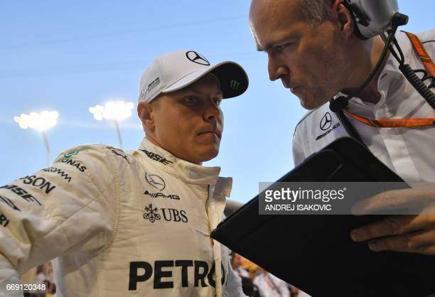 Mercedes' Finnish driver Valtteri Bottas prepares on the starting grid during the Bahrain Formula One Grand Prix at the Sakhir circuit in Manama on...