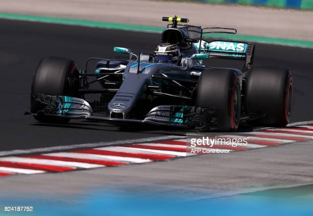 Mercedes' Finnish driver Valtteri Bottas races during a free practice session at the Hungaroring racing circuit in Budapest on July 29 2017 prior to...