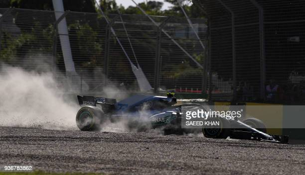 Mercedes' Finnish driver Valtteri Bottas recovers his car at a corner as he drives around the Albert Park circuit during the second Formula One...