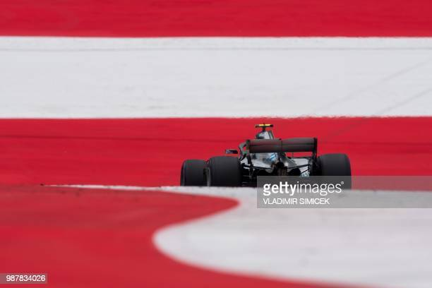 Mercedes' Finnish driver Valtteri Bottas steers his car during the third practice session ahead of the Austrian Formula One Grand Prix in Spielberg...