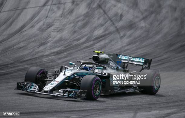 Mercedes' Finnish driver Valtteri Bottas steers his car during the qualifying ahead of the Austrian Formula One Grand Prix in Spielberg central...