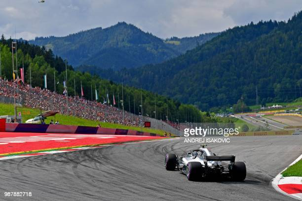 Mercedes' Finnish driver Valtteri Bottas steers his car during the qualifying session ahead of the Austrian Formula One Grand Prix in Spielberg...