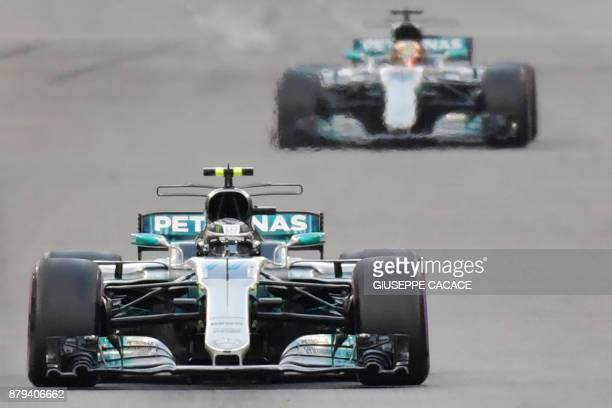 TOPSHOT Mercedes' Finnish driver Valtteri Bottas steers his car followed by Mercedes' British driver Lewis Hamilton during the Abu Dhabi Formula One...