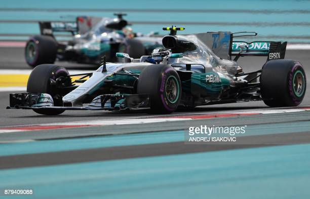 Mercedes' Finnish driver Valtteri Bottas steers his car followed by Mercedes' British driver Lewis Hamilton during the Abu Dhabi Formula One Grand...