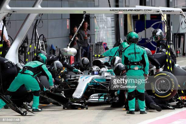 Mercedes' Finnish driver Valtteri Bottas stops in the pits during the British Formula One Grand Prix at the Silverstone motor racing circuit in...