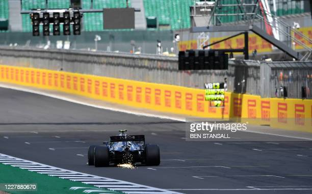 Mercedes' Finnish driver Valtteri Bottas suffers a puncture during the Formula One British Grand Prix at the Silverstone motor racing circuit in...