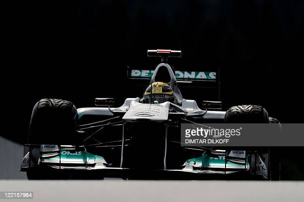 Mercedes' German driver Michael Schumacher enters the pits at the SpaFrancorchamps circuit on August 26 2011 in Spa during the first practice session...