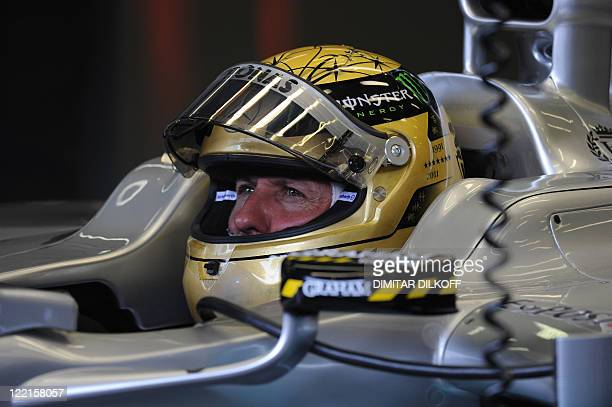 Mercedes' German driver Michael Schumacher sits in the pits at the SpaFrancorchamps circuit on August 26 2011 in Spa during the first practice...