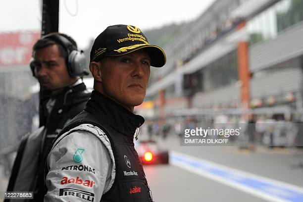 Mercedes' German driver Michael Schumacher stands in the pits after crashing at the SpaFrancorchamps circuit on August 27 2011 in Spa during the...