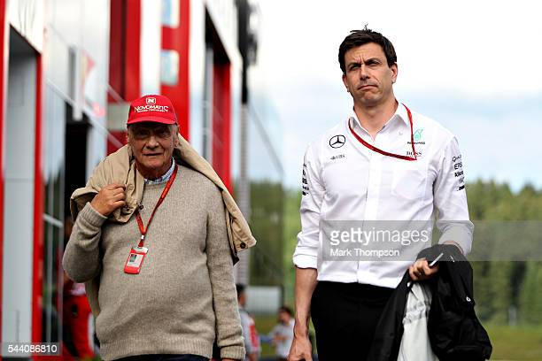 Mercedes GP Executive Director Toto Wolff and Mercedes GP nonexecutive chairman Niki Lauda in the Paddock during practice for the Formula One Grand...