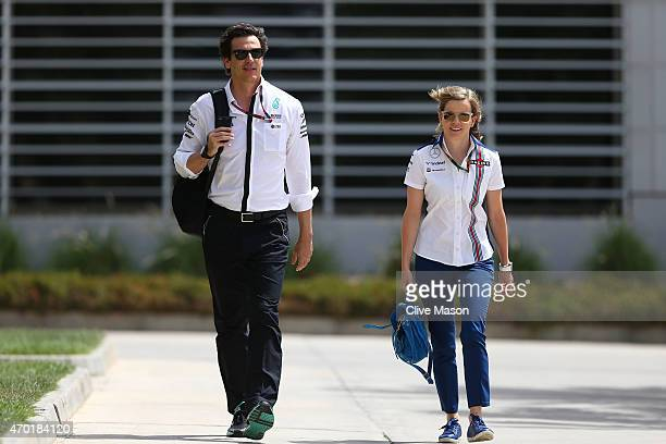 Mercedes GP Executive Director Toto Wolff and Susie Wolff of Wiliams walk into the paddock during final practice for the Bahrain Formula One Grand...