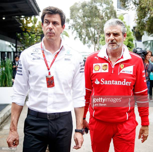 Mercedes GP Executive Director Toto Wolff talks with Ferrari Team Principal Maurizio Arrivabene in the Paddock during practice for the Malaysia...