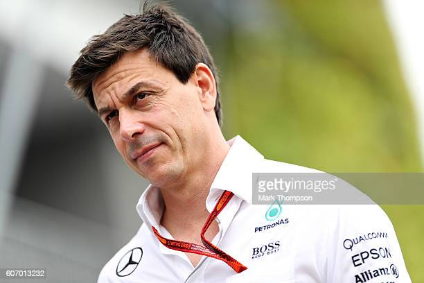 Mercedes GP Executive Director Toto Wolff walks into the paddock before final practice for the Formula One Grand Prix of Singapore at Marina Bay...