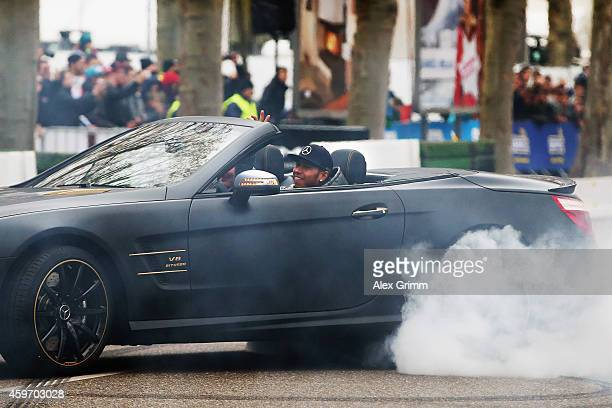 Mercedes GP Formula One driver Lewis Hamilton of Great Britain performs a doughnut AMG SL63 during the annual Mercedes Benz Stars Cars event in front...