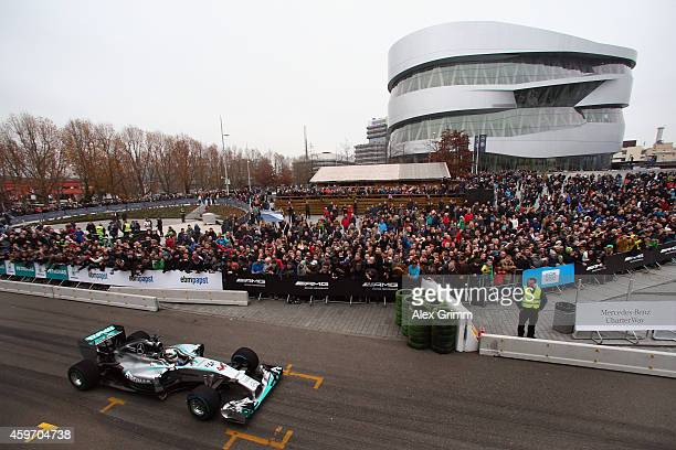 Mercedes GP Formula One driver Lewis Hamilton of Great Britain drives during the annual Mercedes Benz Stars & Cars event in front of the Mercedes...