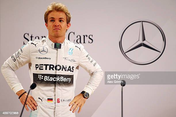 Mercedes GP Formula One driver Nico Rosberg of Germany arrives for a press conference with Toto Wolff, the Mercedes GP Executive Director, during the...