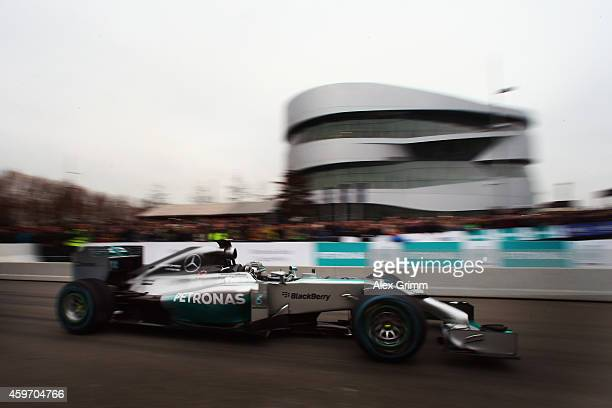 Mercedes GP Formula One driver Nico Rosberg of Germany drives his car during the annual Mercedes Benz Stars & Cars event in front of the Mercedes...